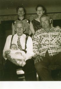 Clockwise from top left: my aunt, my grandma Velma, my great-grandpa Earl, my great-great grandpa Arthur holding my cousin who was born in February 1955.