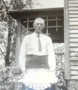Arthur Belknap, with his 60th birthday cake (1929)